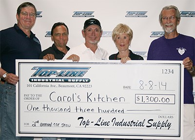Top-Line Donation Check to Carol's Kitchen